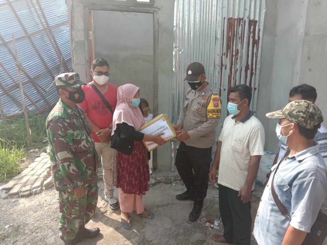 Foto Bantuan sembako, kapolres karimun Akbp adenan, Polres Karimun, Polres karimun salurkan bantuan